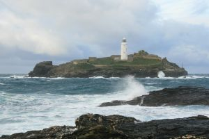 Cornwall Coast with Lighthouse As North Sea oil dwindles, UK eyes ocean energy gusher